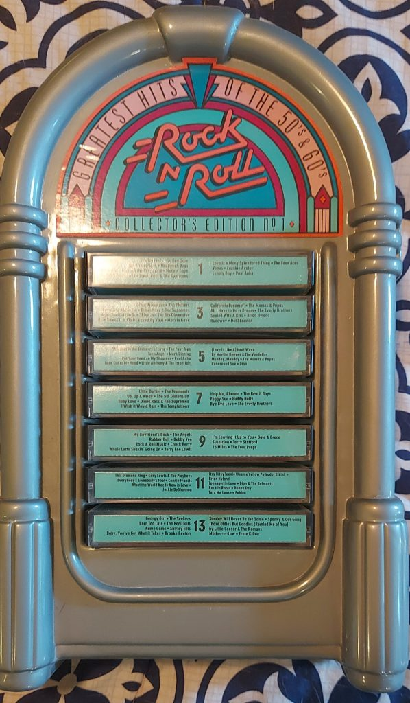The odd editions of Metacom's Greatest Hits of the 50's and 60's - Rock n Roll Collector's Edition in a plastic jukebox shaped case